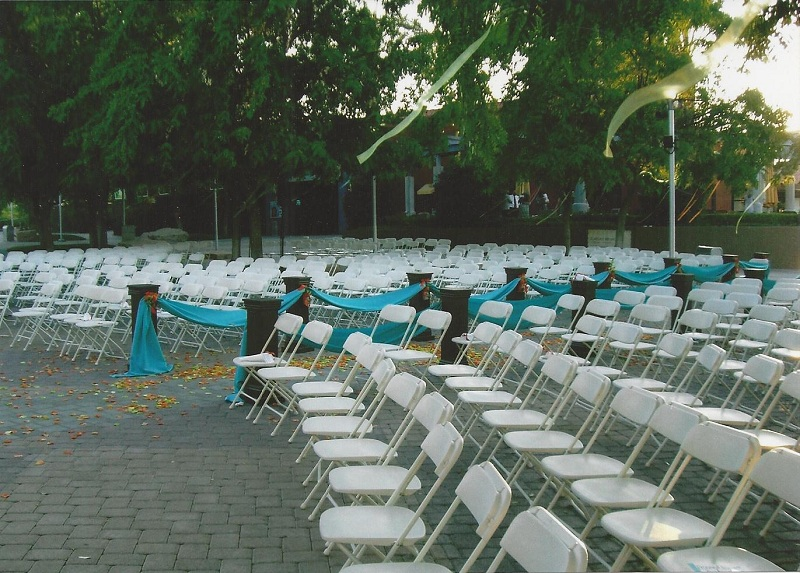 WHITE FOLDING CHAIRS WEDDING EVENT